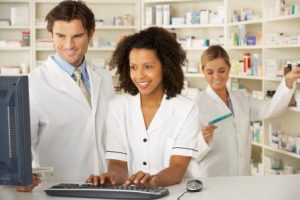 pharmacists and associates working in pharmacy