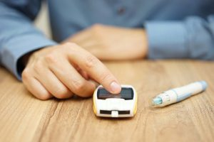 man with glucose meter