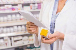 Pharmacist looking at prescription medication